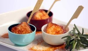 Catering: Pulpo con cachelos y pimentón. puchero de plata